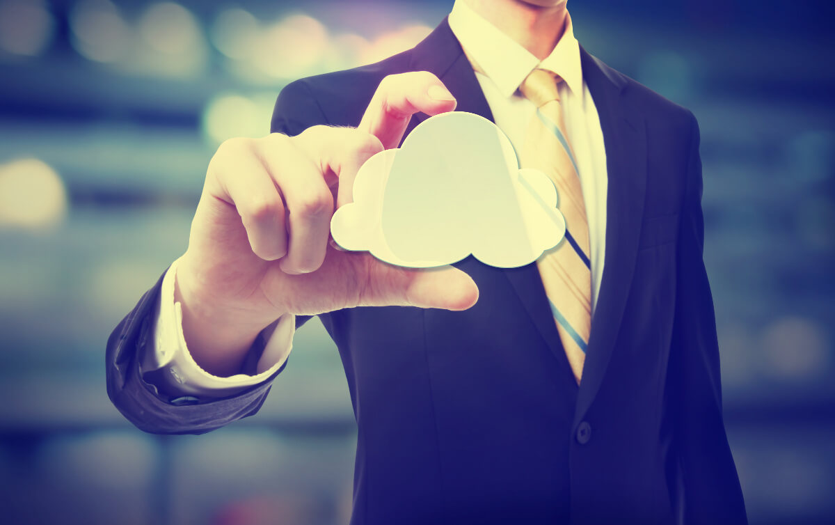 Man In Suit Holding Cloud Computing Image Concept